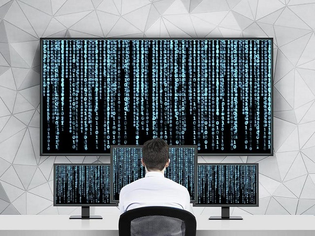 man-in-front-of-computer-viewing-cyber-threats.jpg