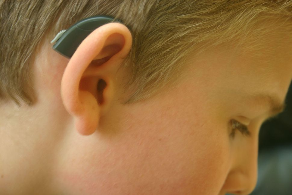 A boy with a hearing aid