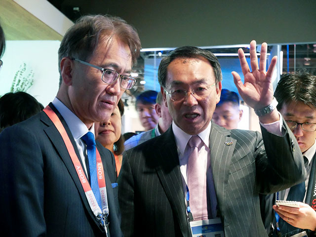 "Mr. Tsuga presenting Sony President and CEO Kenichiro Yoshida at the Panasonic booth at the ""CES 2020"" venue"