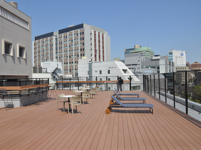 Photo of Axle Ochanomizu office building renovated from Toyota employee dormitory opens to the public-rooftop terrace also features